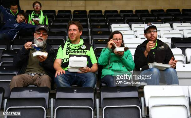 Football fans eat vegan food ahead of the EFL Cup football match between Forest Green Rovers and MK Dons at The New Lawn stadium in Nailsworth...
