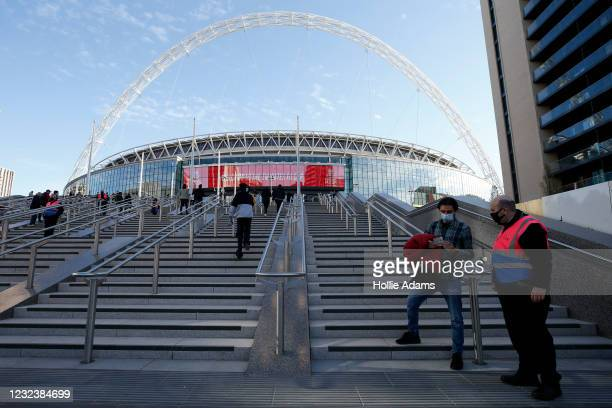 Football fans enter Wembley Stadium on April 18, 2021 in London, England. 4000 local residents have been permitted to attend the Leicester City vs...