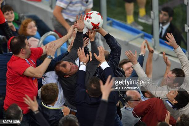 Football fans fight over the match ball at the end of the 2017 Confederations Cup final football match between Chile and Germany at the Saint...
