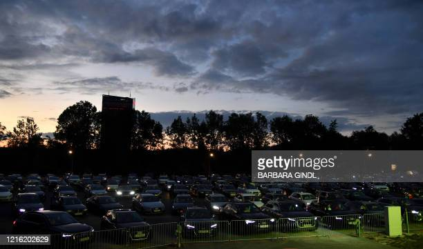 Football fans follow the Austrian Cup final between FC Red Bull Salzburg and SC Austria Lustenau from their cars at a drivein in Salzburg on May 29...