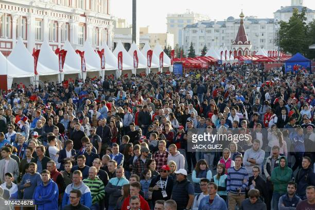 Football fans follow the game between Russia and Saudi Arabia on a giant screen at the Fifa Fans Fest Saransk on June 14 2018 during the Russia 2018...