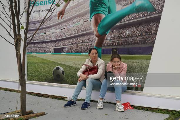 Football fans from across the globe gather at the official FIFA Fan Fest at Moscow State University to watch the first World Cup game between Russia...