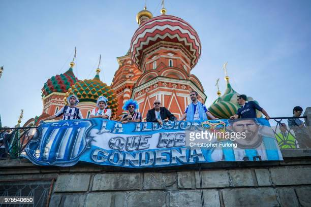 Football fans from Argentina drape their banner over a railing at St Basil's Cathedral in Red Square enjoy the party atmosphere of The World Cup on...