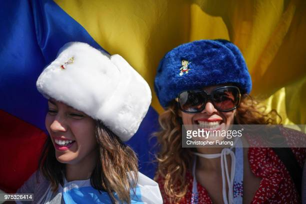 Football fans from Argentina sing songs and enjoy the party atmosphere of The World Cup near Red Square on June 15 2018 in Moscow Russia Russia won...