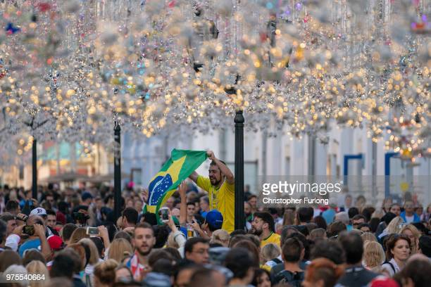Football fans from Brazil sing songs and enjoy the party atmosphere of The World Cup in Nikolskaya Street near Red Square on June 15 2018 in Moscow...