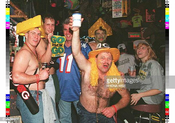 Football fans from Green Bay and New England crowd a Bourbon Street bar in New Orleans Louisiana 24 January as football fans from around the US...