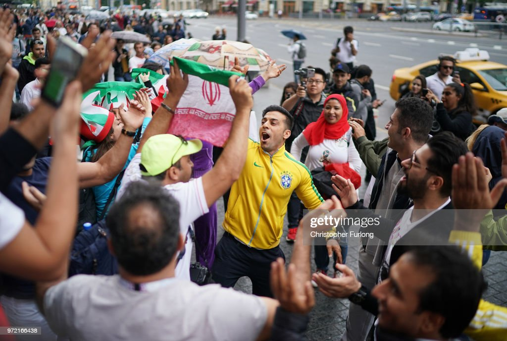 Football fans from Iran and Brazil sing songs together near Red Square ahead of the World Cup on June 12, 2018 in Moscow, Russia. Moscow and Russia are gearing up for the start of the World Cup tournament. FIFA expects more than three billion viewers for the World Cup that begins this week in Russia.