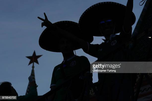 Football fans from Mexico enjoy the party atmosphere of The World Cup in Red Square next to The Kremlin on June 15 2018 in Moscow Russia Russia won...