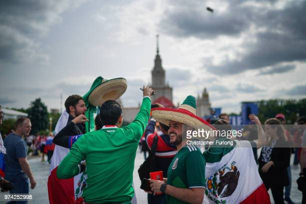 Football fans from Mexico gather at the official FIFA Fan Fest at Moscow State University where they will watch the first World Cup game between...