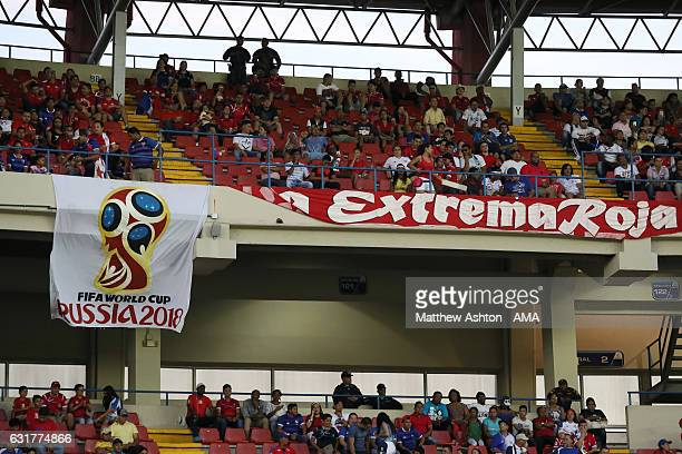 Football fans from Panama watch the game whilst displaying a banner for the FIFA World Cup Russia 2018 and the logo during the Copa Centroamericana...