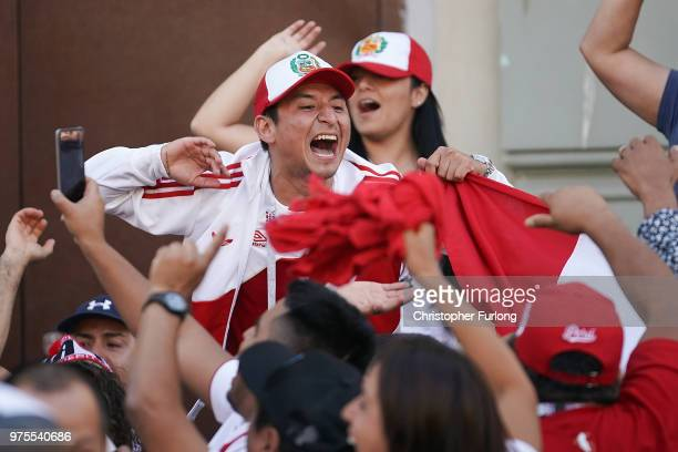 Football fans from Peru sing songs and enjoy the party atmosphere of The World Cup in Nikolskaya Street near Red Square on June 15 2018 in Moscow...