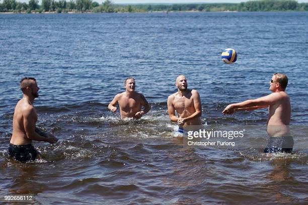 Football fans from Sweden play volley ball in the River Volga on July 6 2018 in Samara RussiaFootball fans from England and Sweden are arriving in...