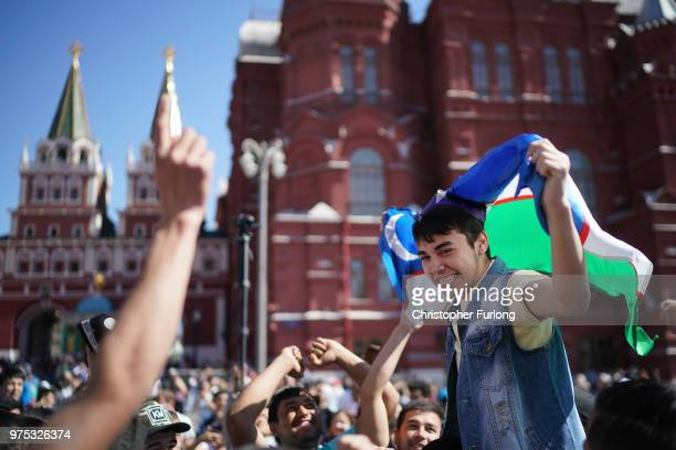 Football fans from Uzbekistan join in the party atmosphere of The World Cup near Red Square on June 15 2018 in Moscow Russia Russia won the opening...