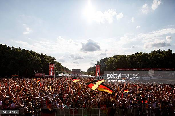 Football fans gather before the beginning of the 2016 UEFA European Championship match between Germany and Northern Ireland at a public viewing area...