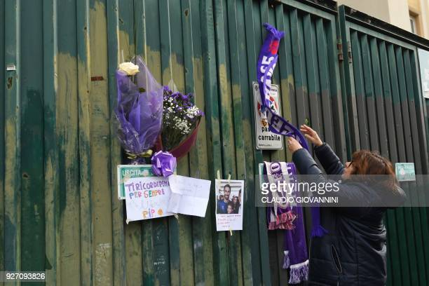 Football fans hang scarves and hommages to late Fiorentina's captain Davide Astori on the fence of Fiorentina's stadium on March 4 2018 in Florence...