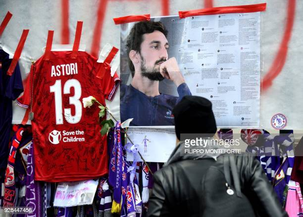 TOPSHOT Football fans hang scarves and tributes to late Fiorentina football team captain Davide Astori on the fence of the team stadium on March 7...