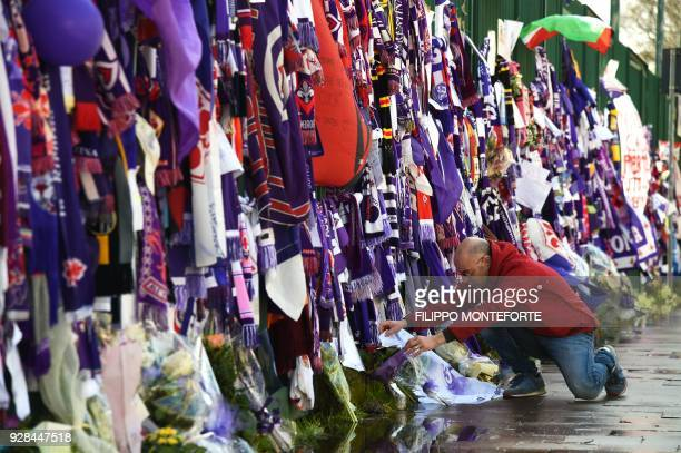 Football fans hang scarves and tributes to late Fiorentina football team captain Davide Astori on the fence of the team stadium on March 7 2018 in...