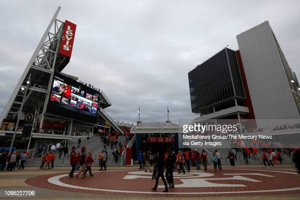 Football fans head into Levi's Stadium before the 2019 College Football Playoff National Championship game in Santa Clara, Calif., on Monday, Jan. 7,...