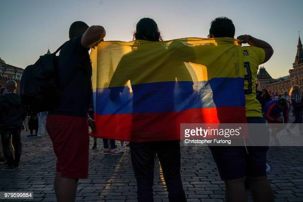 Football fans in Red Square pose for photographs on June 20 2018 in Moscow Russia Uruguay's 10 win over Saudi Arabia has ensured that they and host...