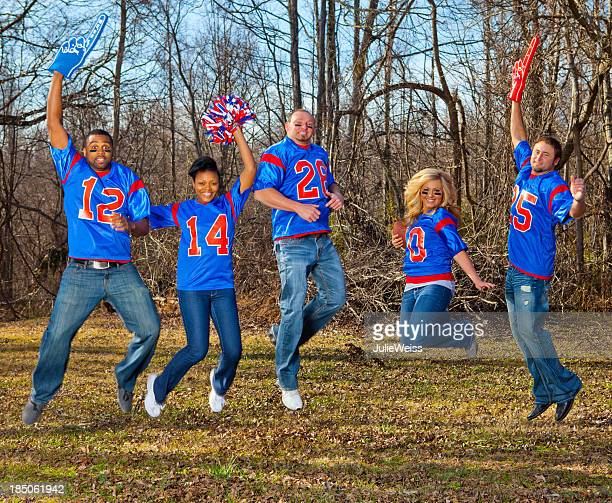 football fans jumping - foam finger stock photos and pictures