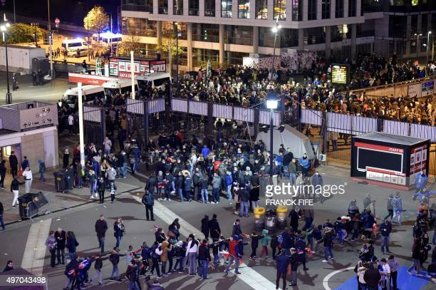 Football fans leave the Stade de France stadium following the friendly football match between France and Germany in Saint-Denis, north of Paris, on...