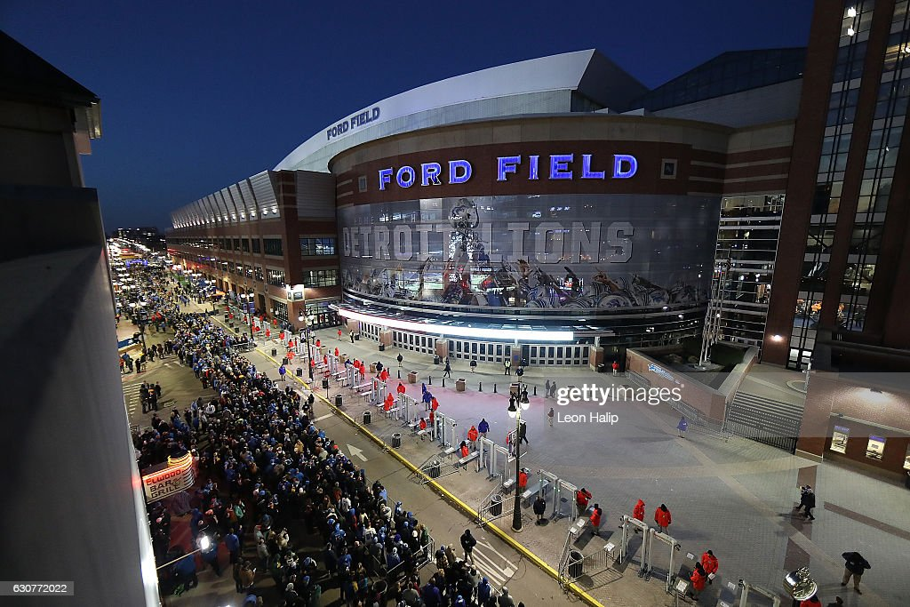 Football fans line up prior to the start of the game between the Green Bay Packers and the Detroit Lions at Ford Field on January 1, 2017 in Detroit, Michigan.