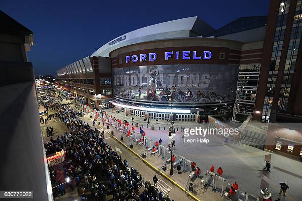 Football fans line up prior to the start of the game between the Green Bay Packers and the Detroit Lions at Ford Field on January 1 2017 in Detroit...