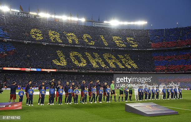 Football fans mark the words 'Thankyou Johan' in memeory of the late Dutch football legend Johan Cruyff before the 'clasico' Spanish league football...