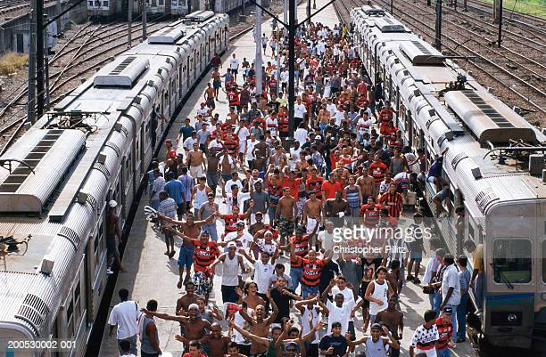 Football fans mostly from Flamengo club disembark from a train running into the Central station of Rio de Janeiro, Brazil.