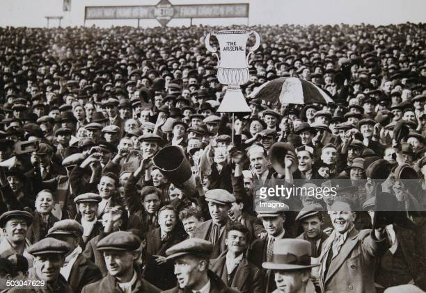Football Fans of FC Arsenal at the Highbury Stadium the home ground of FC Arsenal before the Cupplayoff against Aston Villa 3rd March 1934 Photograph