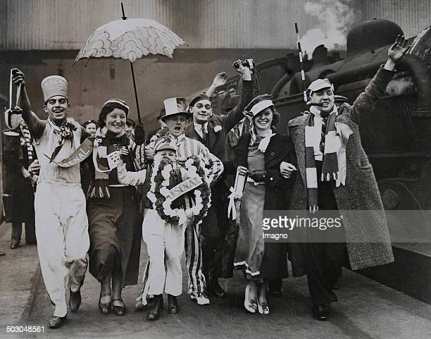 Football Fans of FC Arsenal on the King's Cross station on the way to Huddersfield for the Cup playoff against Huddersfield 21 March 1936 Photograph