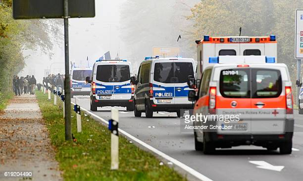 Football fans of Karlsruhe walk to the stadium with police protection prior to the Second Bundesliga match between Karlsruher SC and VfB Stuttgart at...