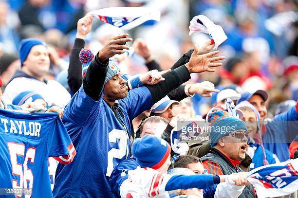 Football Fans of the New York Giants cheer on their team against the Atlanta Falcons during the NFC Wild Card Game at MetLife Stadium on January 8...