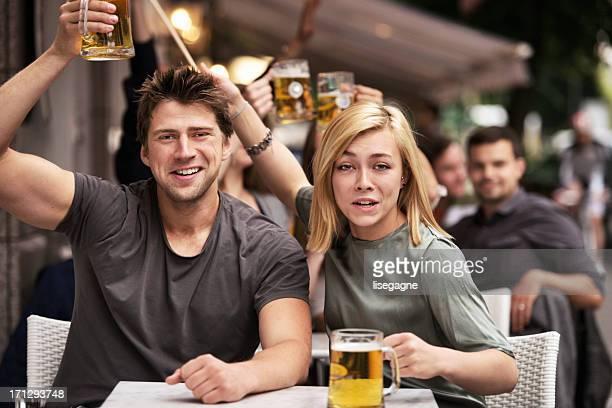 Football fans on sidewalk bar