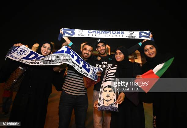Football fans pose for photographs prior to the FIFA Club World Cup UAE 2017 semi final match between Al Jazira and Real Madrid CF at Zayed Sports...