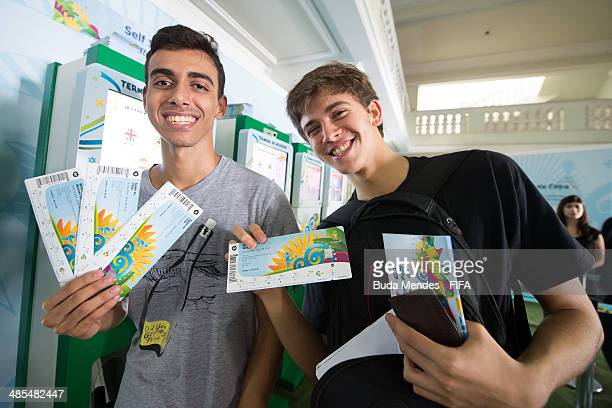 Football fans purchase tickets during a FIFA venue ticketing centre opening for the 2014 FIFA World Cup at Casarao General Severiano on April 18 2014...