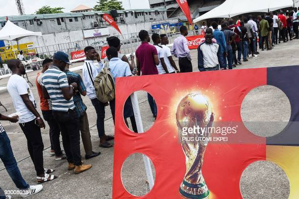 Football fans queue to view FIFA World Cup trophy on arrival at the Tafawa Balewa Square in Lagos on March 10 2018 The FIFA World Cup trophy has...