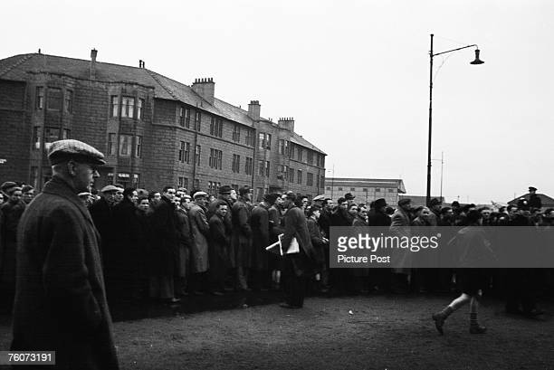 Football fans queuing to get into Ibrox to see Rangers play Celtic in an Old Firm match 15th October 1949 Original Publication Picture Post 4894...