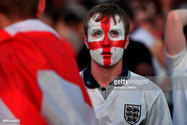 Football fans react as they watch England lose to Croatia at the Auto Trader World Cup semifinal screening in Castlefield Bowl on July 11 2018 in...