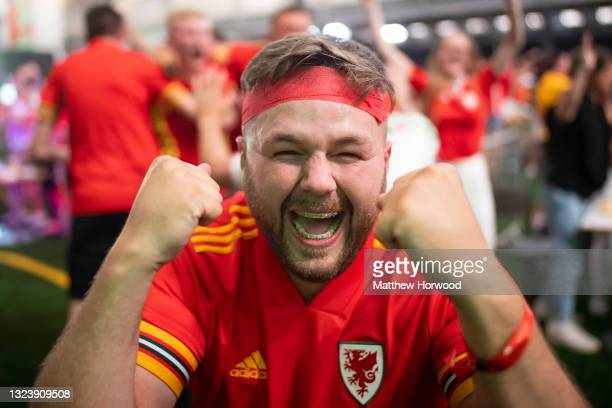 Football fans react as they watch Wales v Turkey at the Vale Sports Arena on June 16, 2021 in Penarth, Wales. The 2020 UEFA European Championship was...