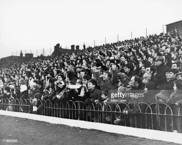 Football fans standing on the terraces at Arsenal FC's home ground in Highbury, North London, during a game against Everton 1st January 1972.