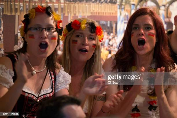 Football fans supporting the German national team watch the FIFA World Cup final on a big screen in the 'Bavarian Beerhouse' pub in East London on...