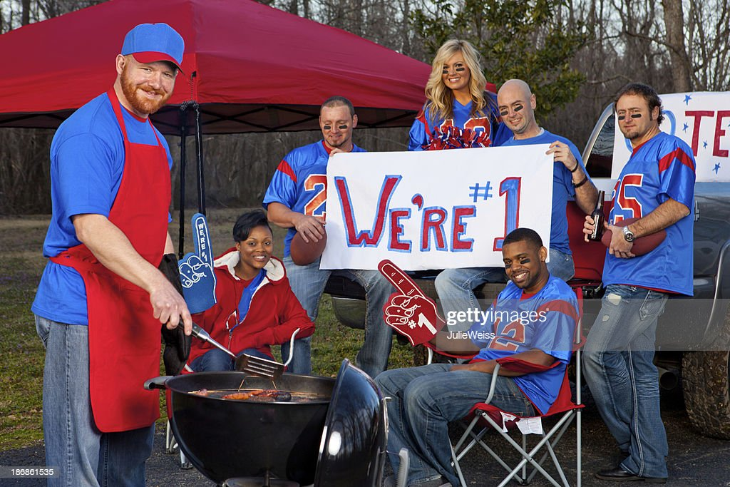 Football fans tailgating : Stock Photo