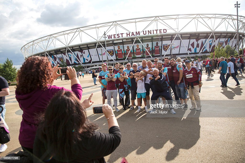 Football fans take pictures as they arrive to watch West Ham United v NK Domzale at the London Stadium on August 4, 2016 in London, England. West Ham United play for the first time tonight at the former Olympic Stadium, which hosted the London 2012 Games, since moving from their former home at Upton Park.
