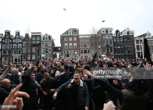 Football fans throw beer cans into the air before the International Friendly match between Netherlands and England at Amsterdam Arena on March 23...