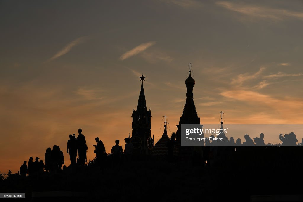 Football fans, tourists and The Kremlin is silhouetted at sunset during The World Cup tournament n June 15, 2018 in Moscow, Russia. Russia won the opening game of the tournament against Saudi Arabia 5-0.