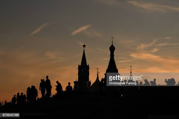 Football fans tourists and The Kremlin is silhouetted at sunset during The World Cup tournament n June 15 2018 in Moscow Russia Russia won the...