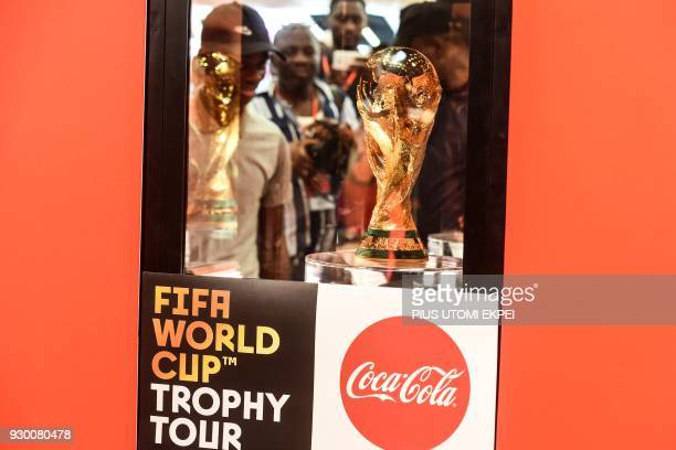 Football fans view the FIFA World Cup trophy on display at Tafawa Balewa Square in Lagos on March 10 2018 The FIFA World Cup trophy has arrived in...