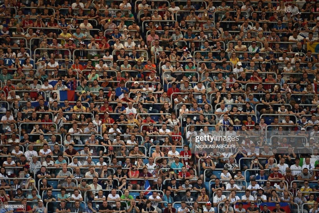TOPSHOT - Football fans wait before the Russia 2018 World Cup Group D football match between Nigeria and Iceland at the Volgograd Arena in Volgograd on June 22, 2018. (Photo by NICOLAS ASFOURI / AFP) / RESTRICTED