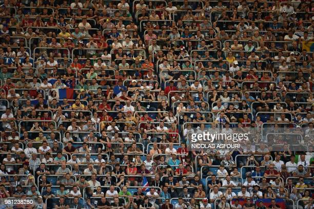 TOPSHOT Football fans wait before the Russia 2018 World Cup Group D football match between Nigeria and Iceland at the Volgograd Arena in Volgograd on...